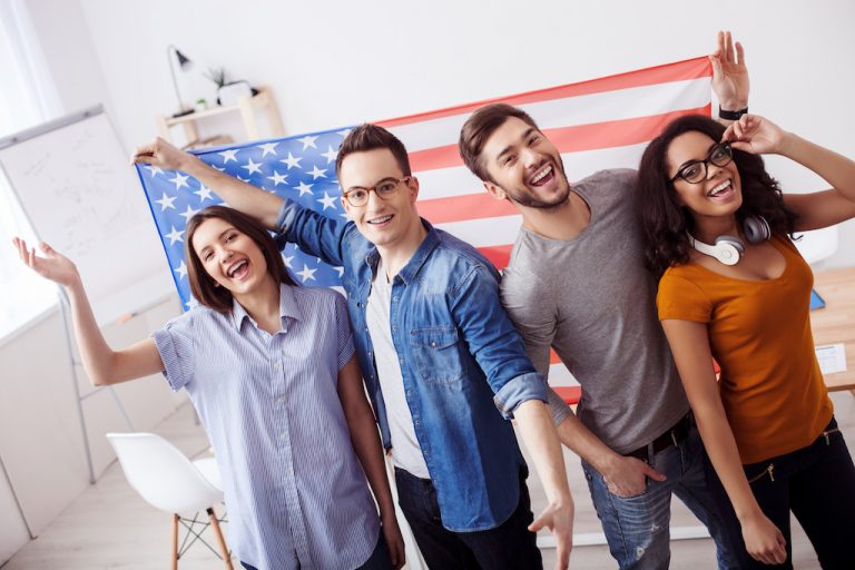 Students in front of American flag