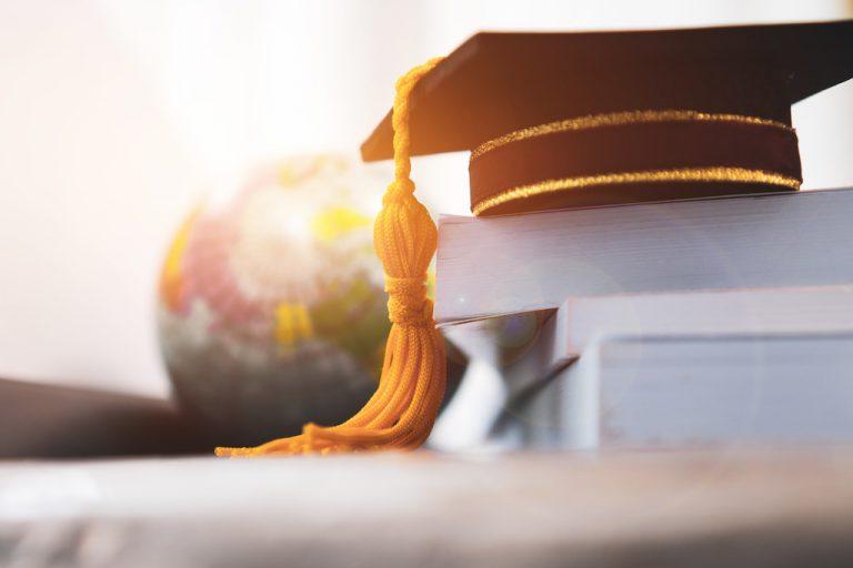 Graduation cap on stack of books