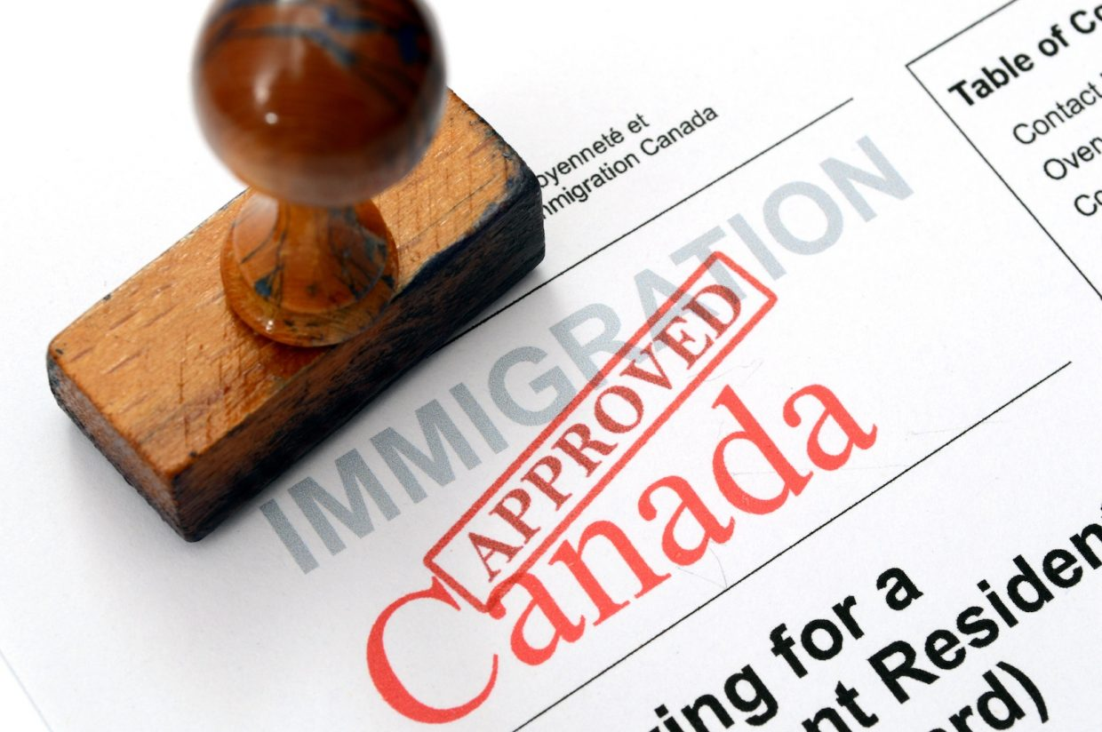 Approved stamp on Canadian immigration form