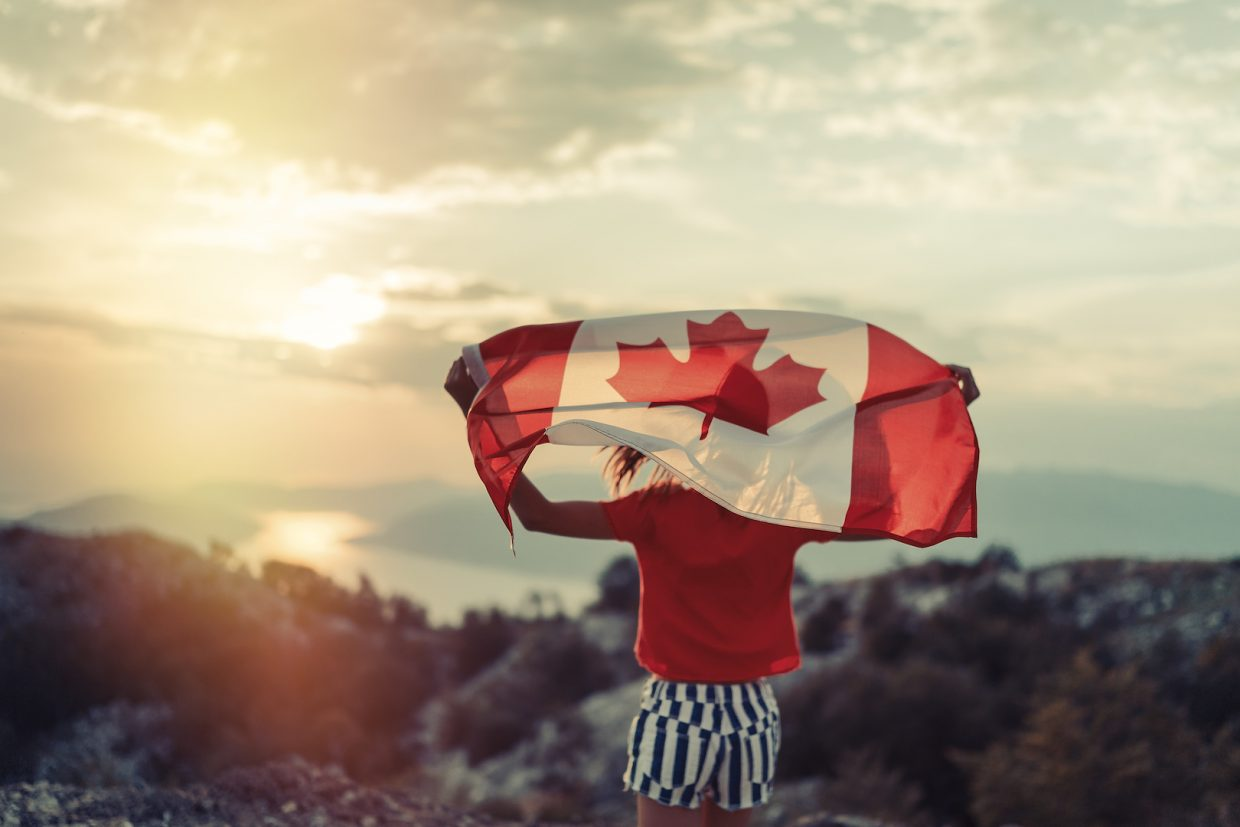 Person holding Canada flag
