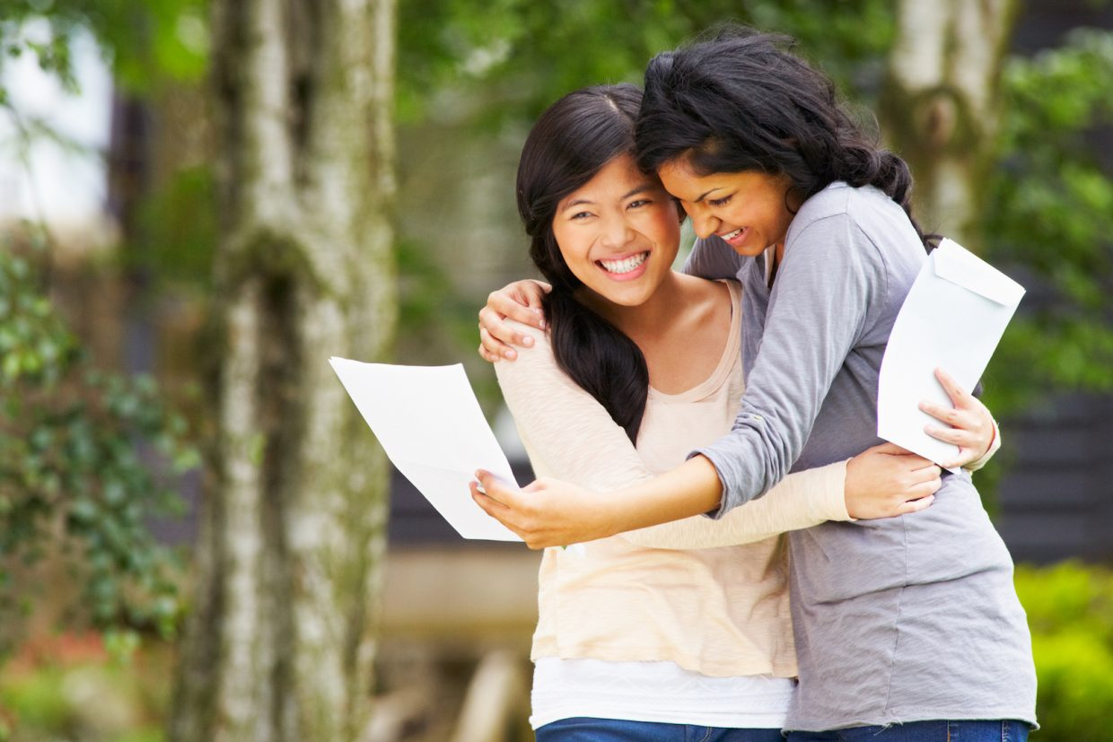 Mom and daughter hug after receiving acceptance letter