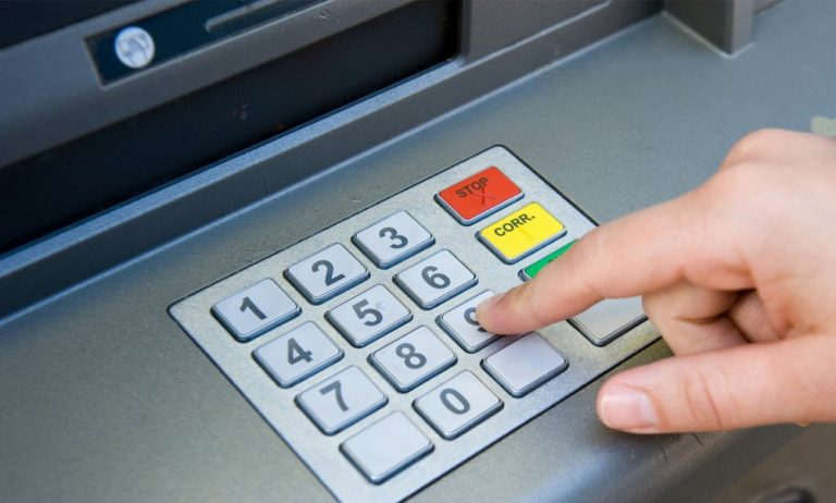 Person pressing ATM buttons