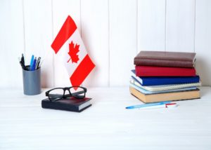 Canadian flag and books