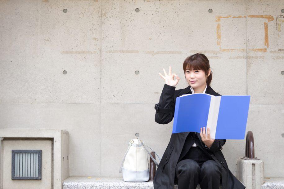 Woman holding binder