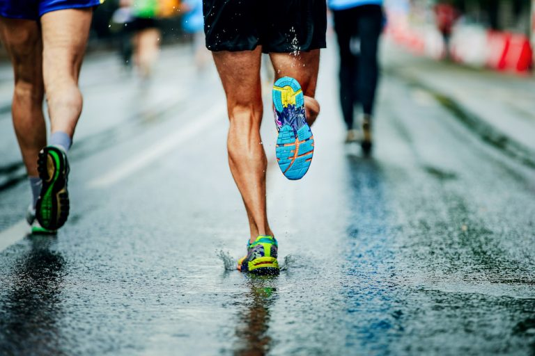 People running on wet pavement