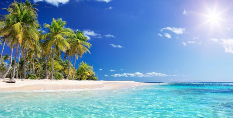 Tropical beach with sun shining