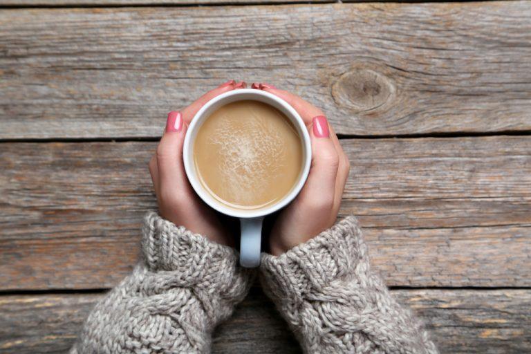 Woman drinking latte