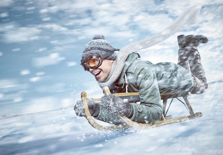 Man sledding downhill