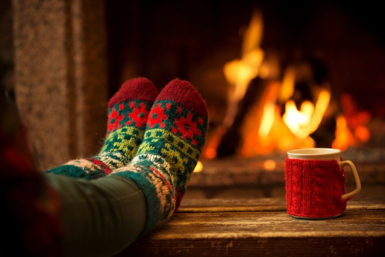 Person cozy by the fireside
