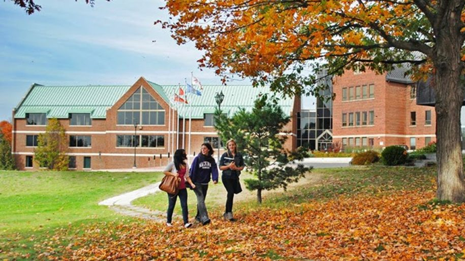 Students walking on Algoma University campus in fall