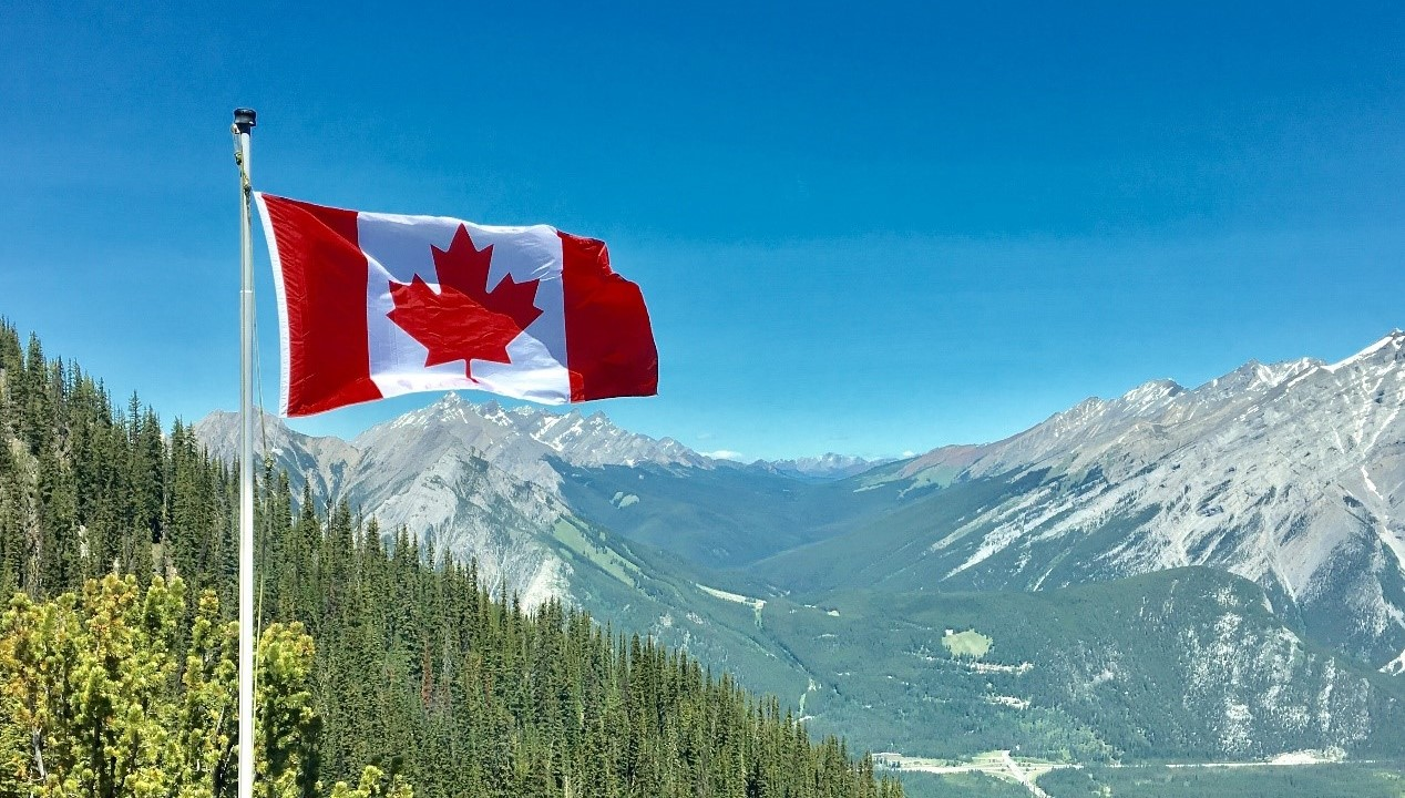 Canadian flag against mountains