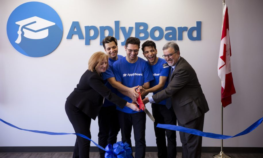 ApplyBoard's CMO, CEO, and COO cutting a blue ribbon with Ward 10 Councillor for Kitchener Sarah Marsh and University of Waterloo President Feridun Hamdullahpur.