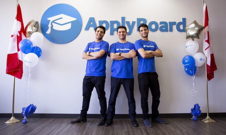 ApplyBoard's CEO, CMO, and COO in front of ApplyBoard's sign