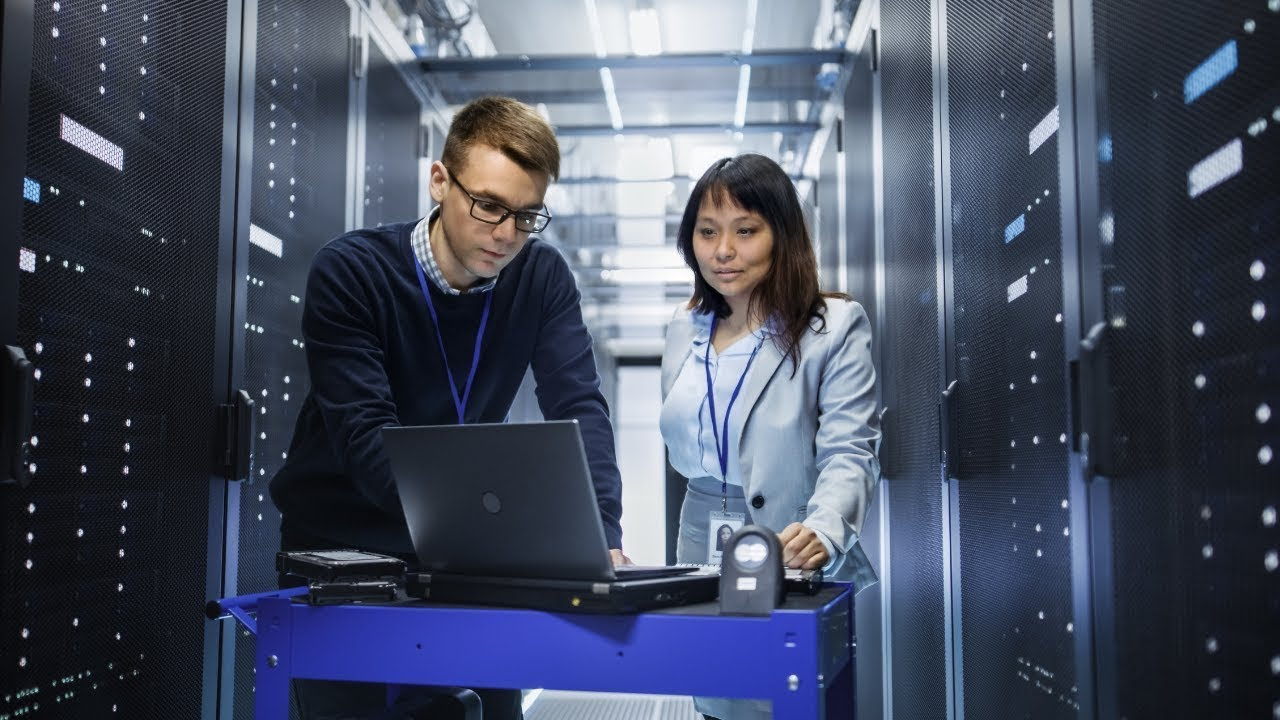 Two people in server room
