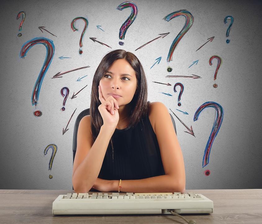 Woman thinking at keyboard