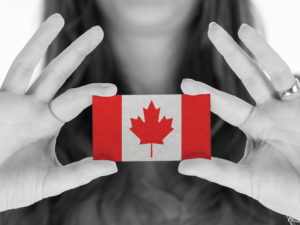 Woman holding small Canadian flag