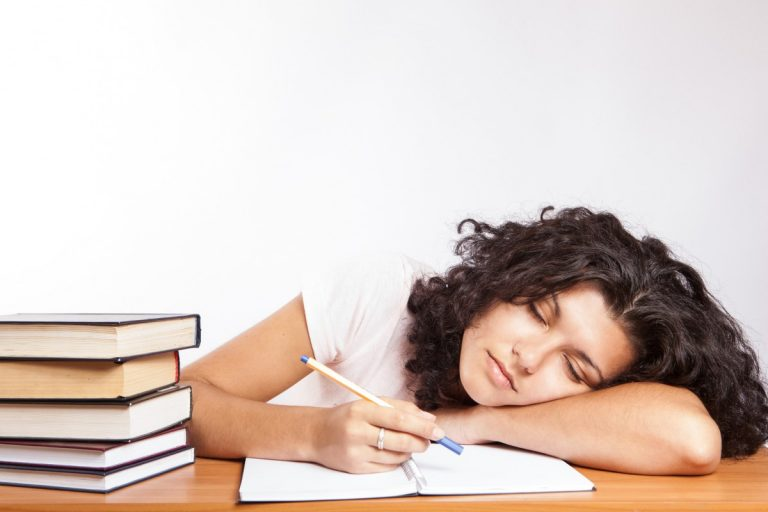 Student falling asleep while studying