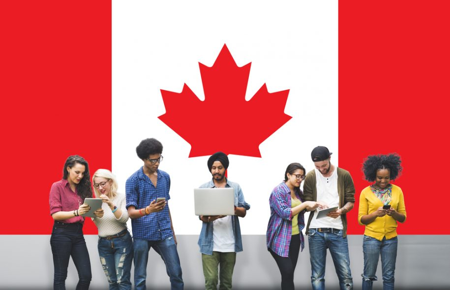 Students standing in front of Canadian flag
