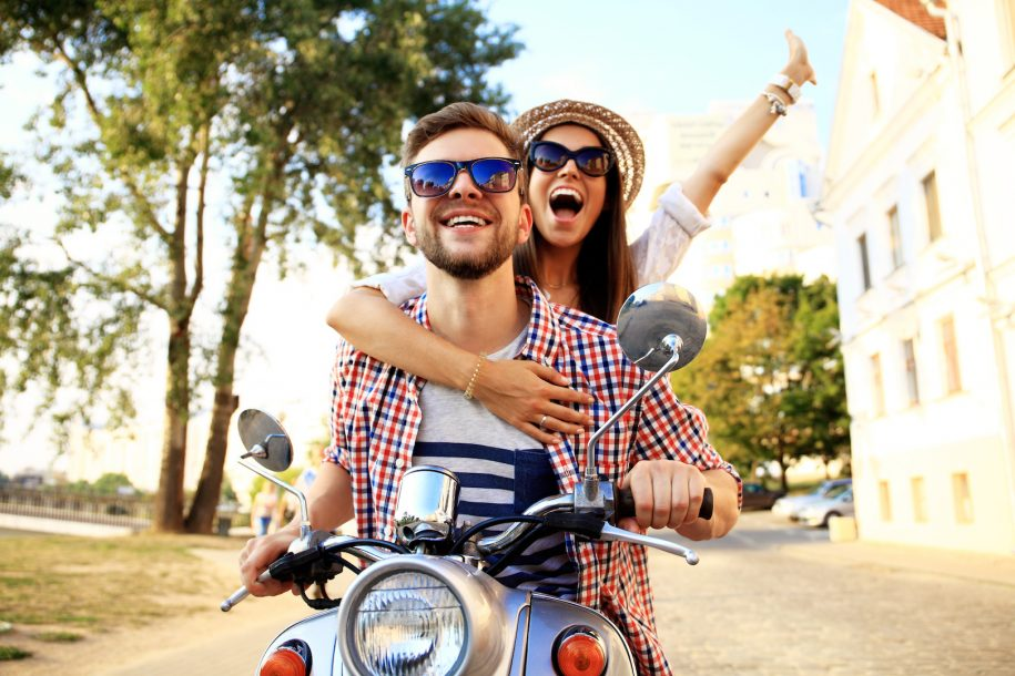 Man and women riding on moped