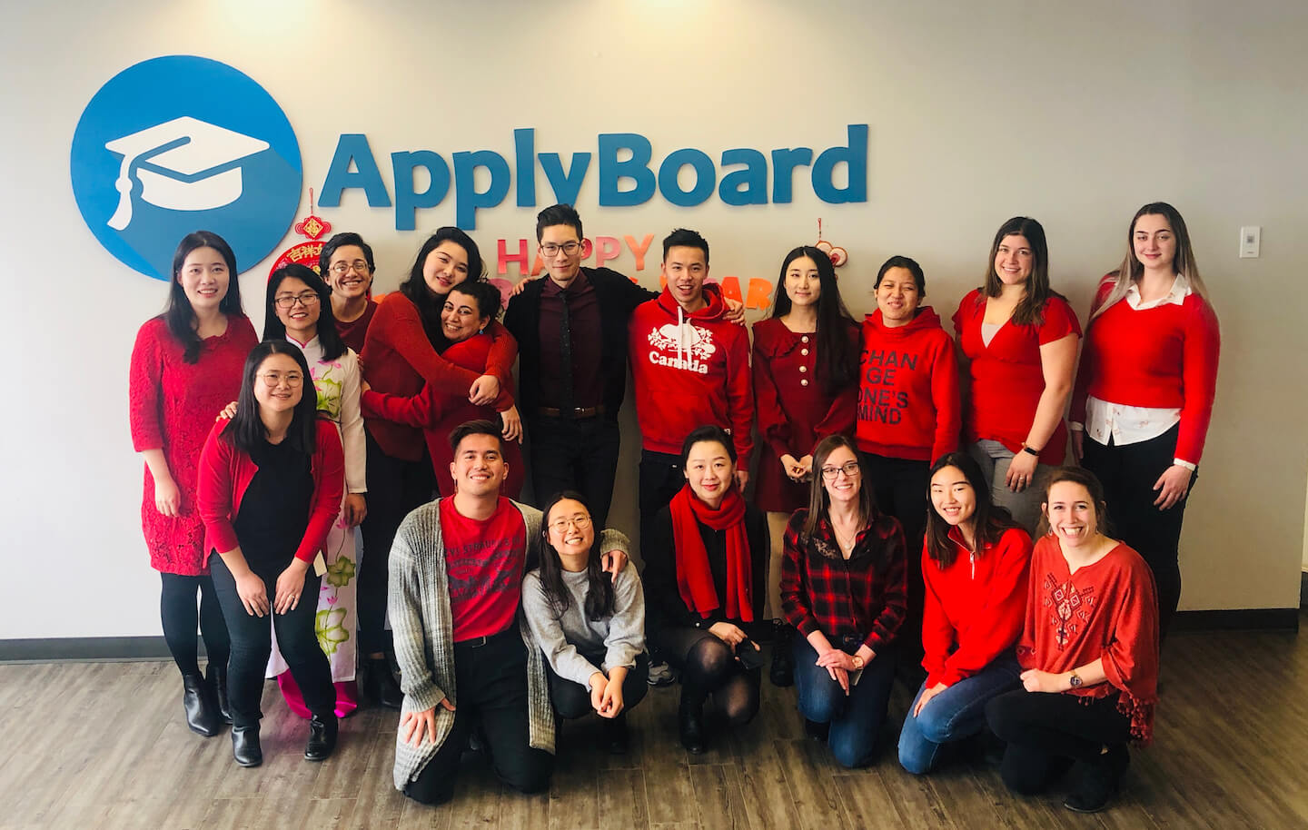 ApplyBoard staff wearing red at the office Lunar New Year celebration