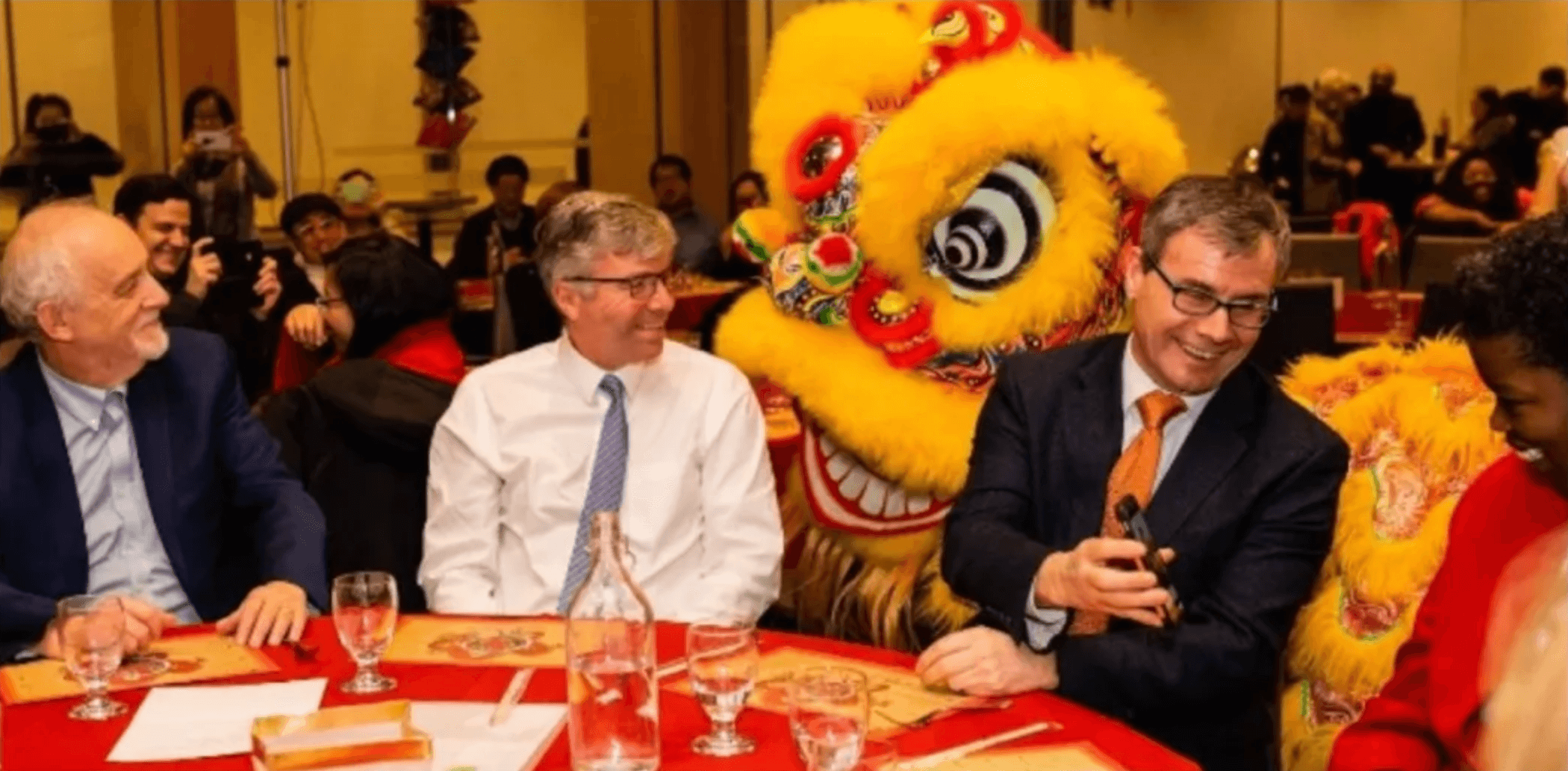 Event attendees entertained by Chinese lion