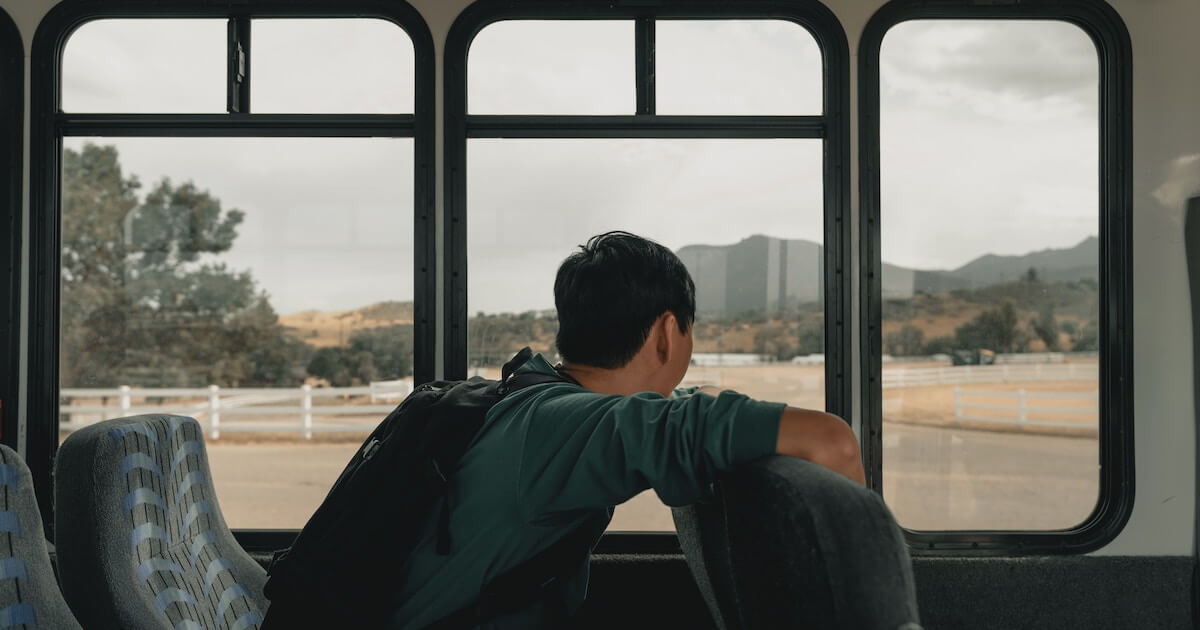 Student looking out bus window