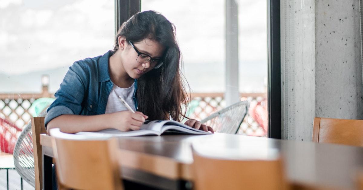 Girl working in notebook