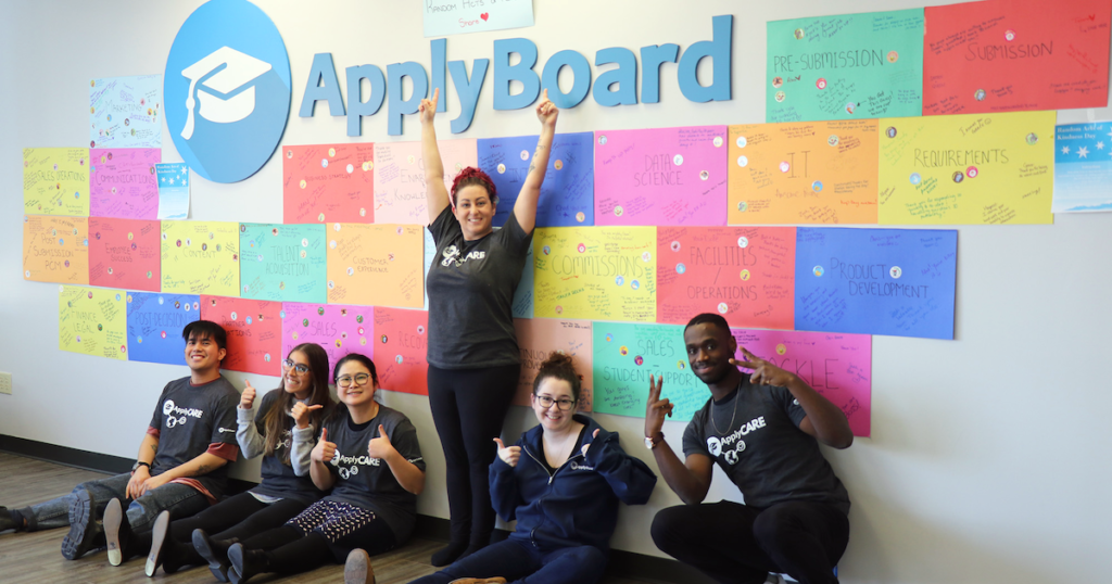 The ApplyCare Team with their Random Acts of Kindness wall
