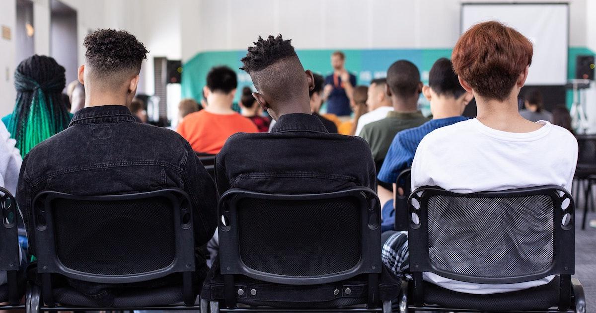Students sitting in school presentation