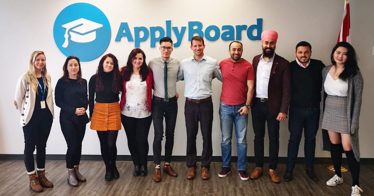 Kelvin with his team during a school visit at the ApplyBoard office