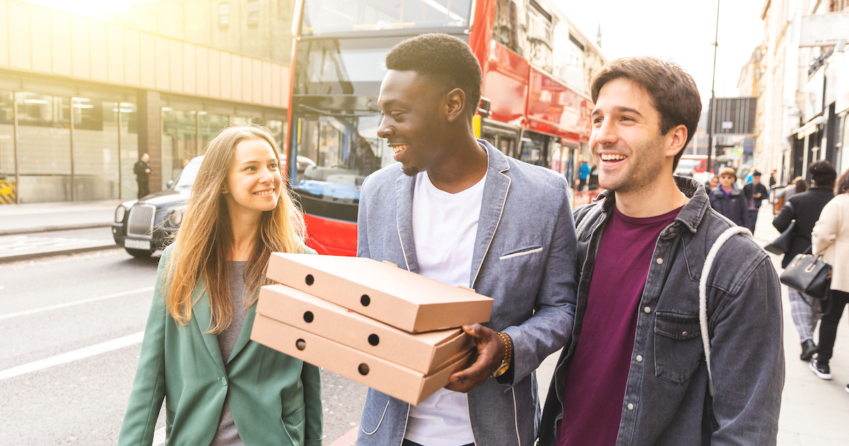 Friends with takeout food in London