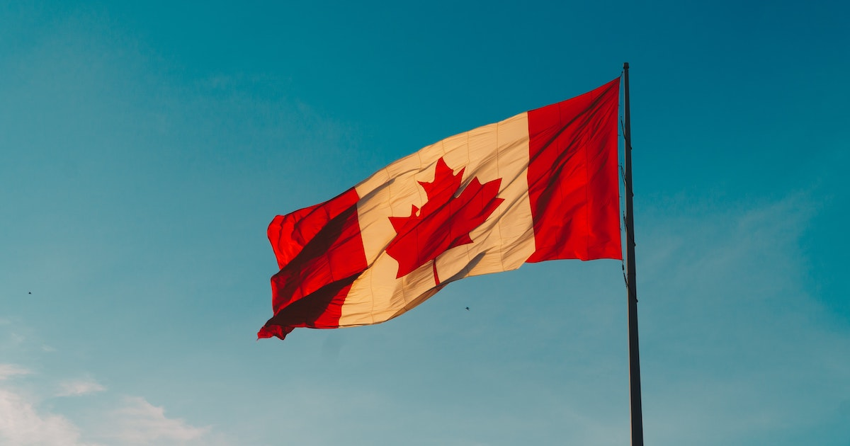 Canada flag against sky