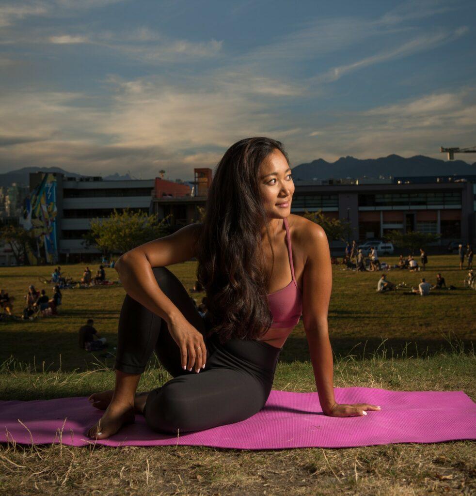Diana Change doing yoga