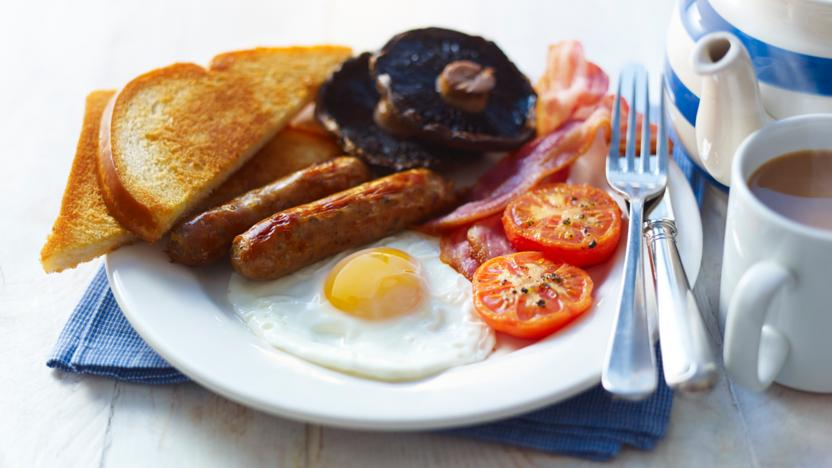 Plate with eggs, sausage, toast, tomatoes, and mushrooms