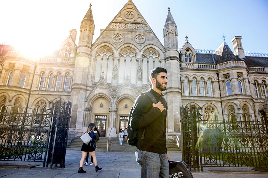 Male student in front of Nottingham Trent University