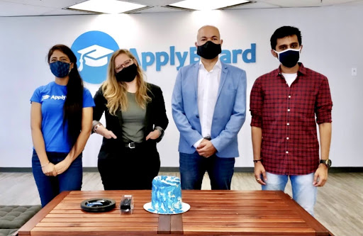 ApplyBoard staff, in office, wearing masks