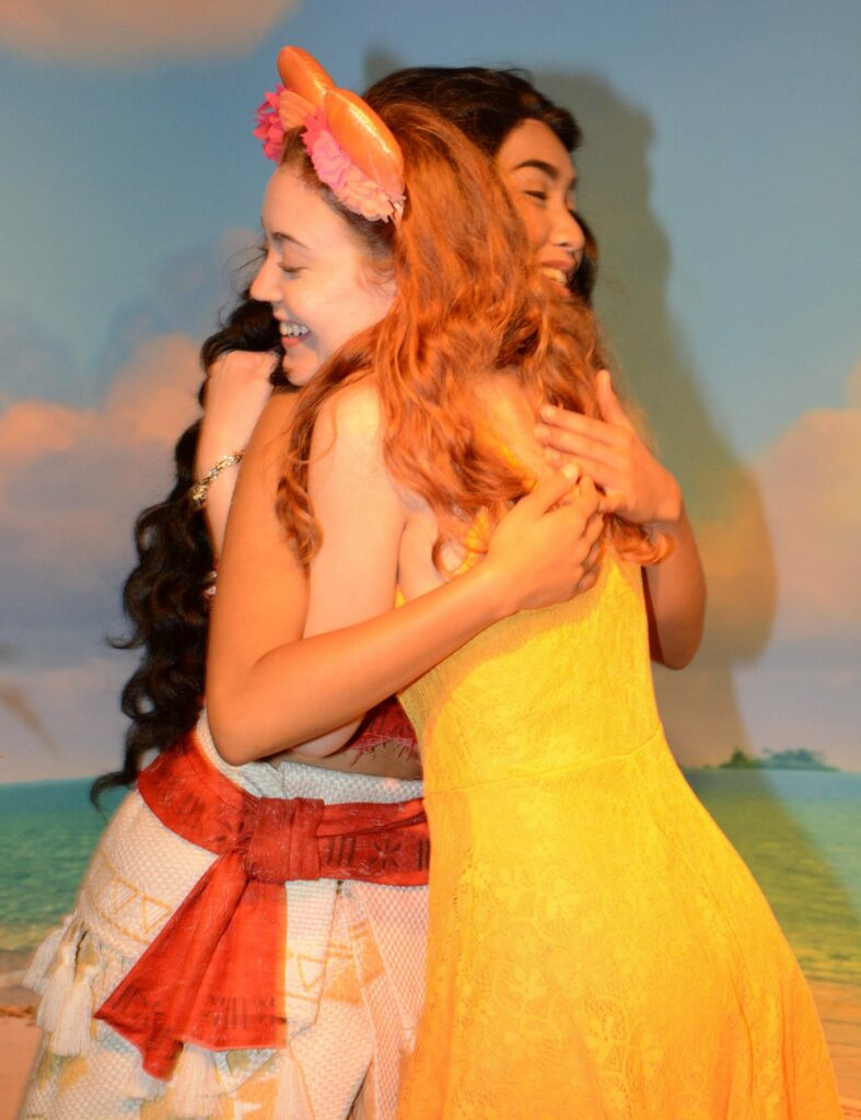 ApplyBoard team member hugging Moana at Walt Disney World