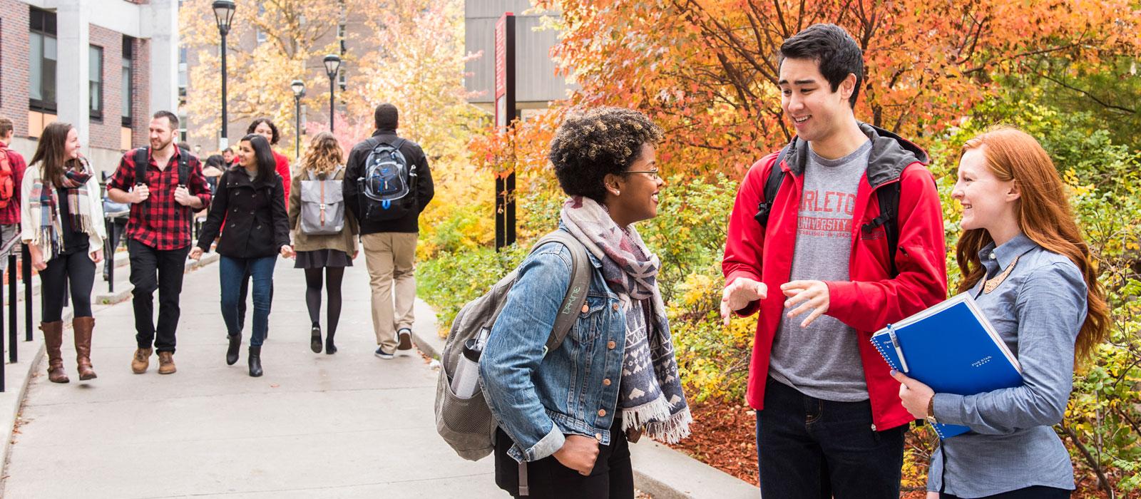 Carleton University students chatting and walking
