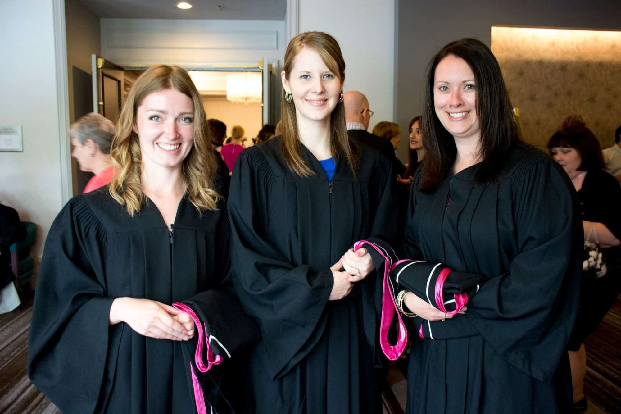 Photo of three Yorkville University graduates