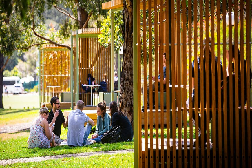 A photo of students gathering on the University of Wollongong campus.