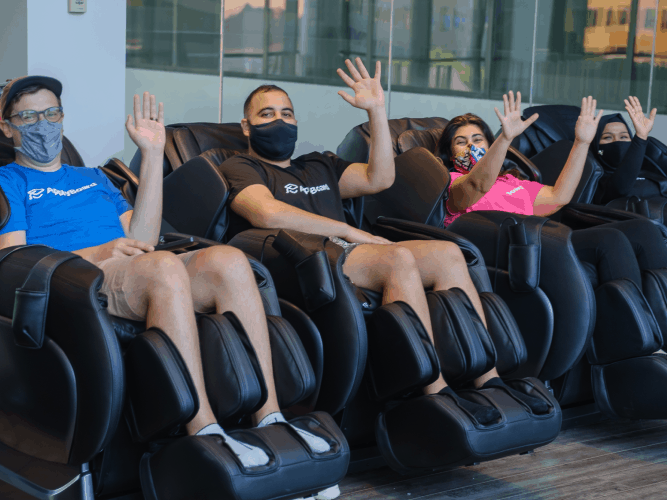 Our ApplyBoard team members in our massage chairs