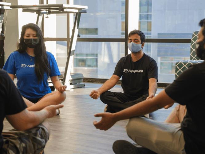 Our ApplyBoard team members meditating