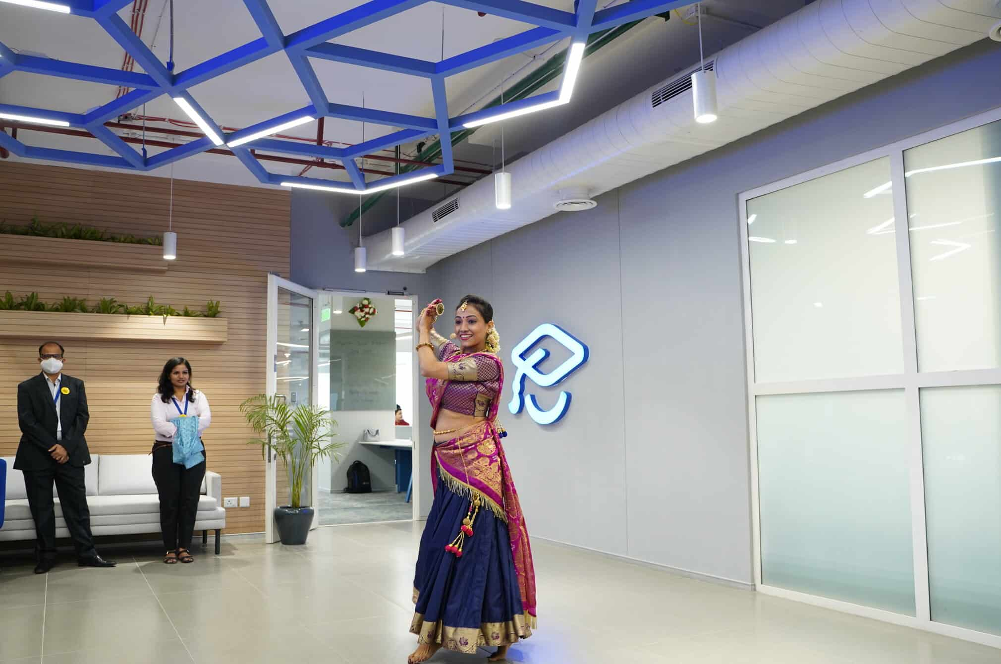 A woman dancing in the new India office.
